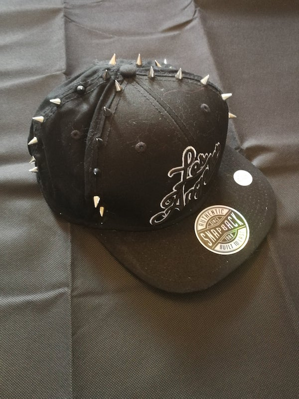 black snap back cap with silver spike studs