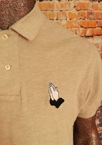 tshirt praying hands patch polo shirt closeup